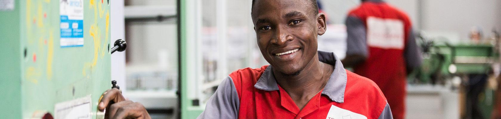 factory Transpaper, Kampala, Uganda, worker