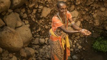 A samburu woman at Kenya well AFD Water
