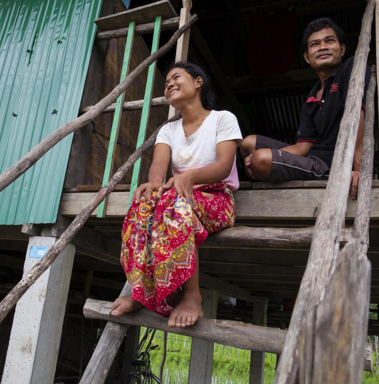 Couple in front of their house, Cambodia