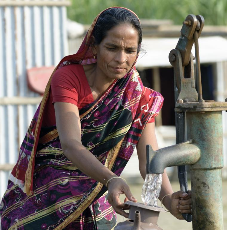 Woman filling her jug of water, Bangladesh