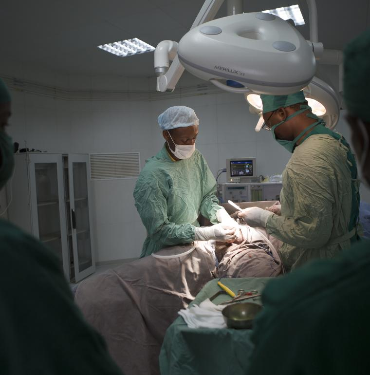 Surgeons in the operating theater with a patient who has to have an operation at Somine Dolo Hospital in Mali health sector
