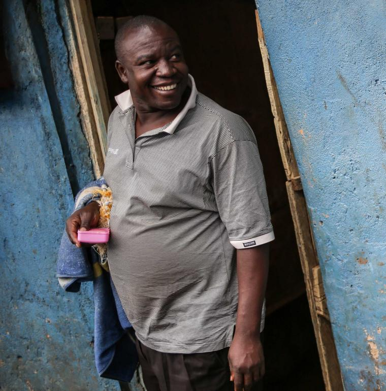 A man at a sanitary block in Kibera / James Keogh