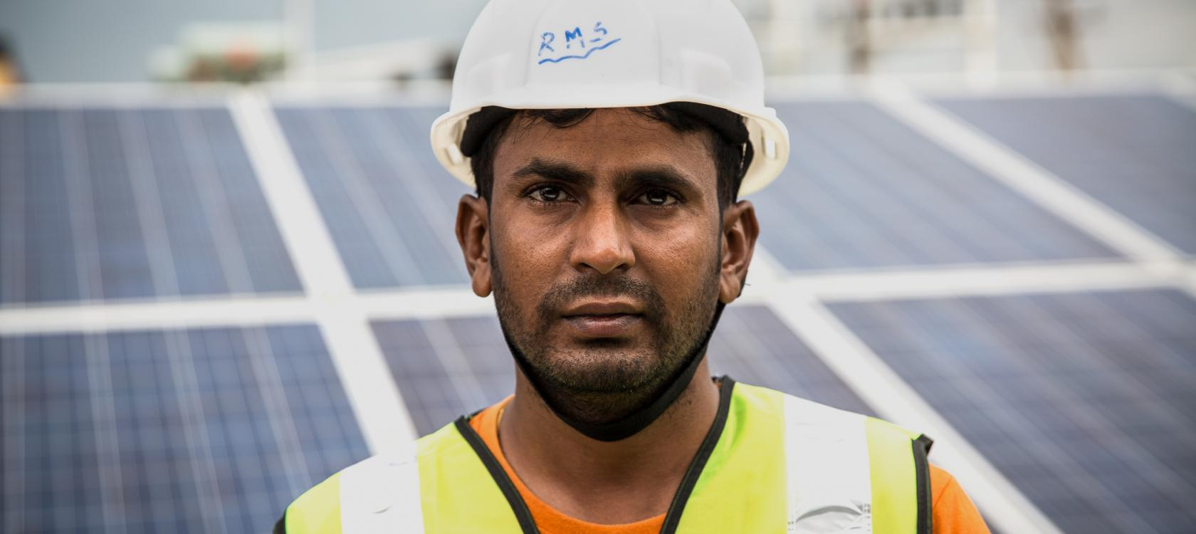 worker, man, renewable energy, solar panels, India